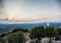 The concrete cross dated 1933. It marks the end of the Via Crucis on top of the Mt. Krizevac. Medjugorje, Bosnia and Herzegovina. July 2012