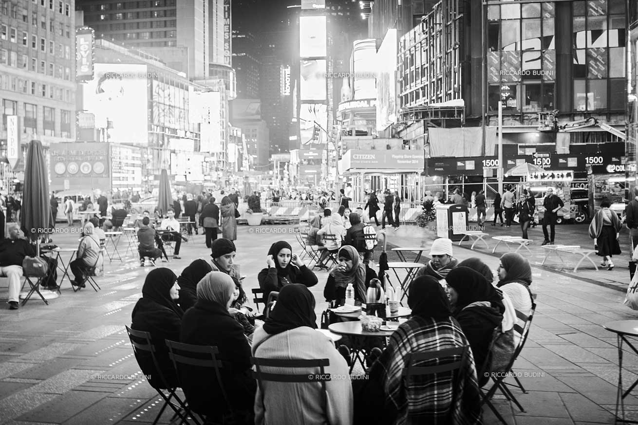 A group of Muslim women in Times Square have a meal