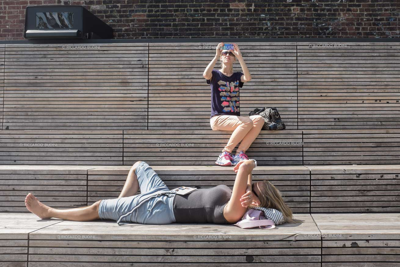 People enjoying the sun on the High Line.