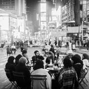 Muslim women in their typical clothing have a dinner in Times Square
