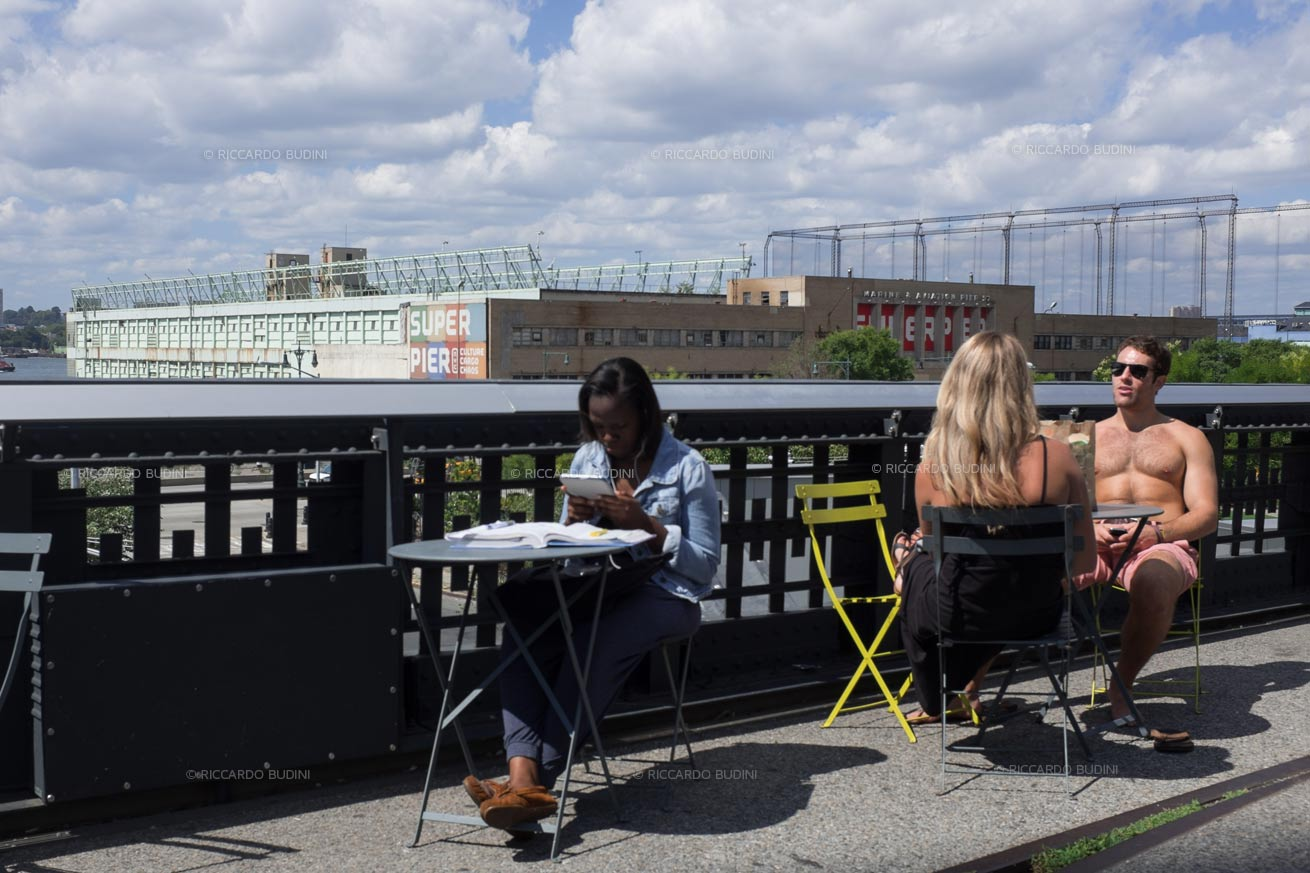 People enjoy the sun on the High Line