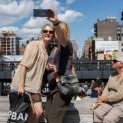 Tourists take photos on the High Line