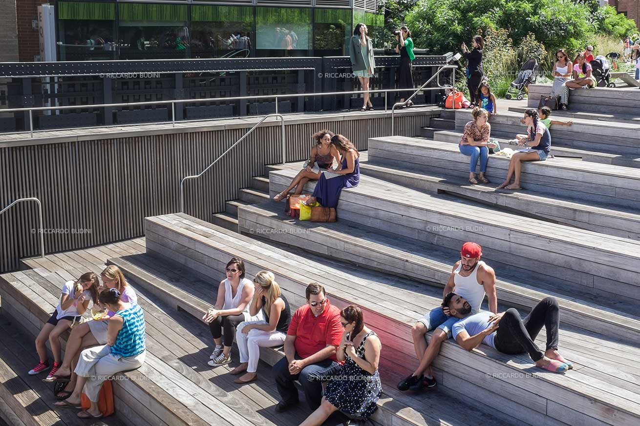 People enjoying the sun on the High Line. New York City.