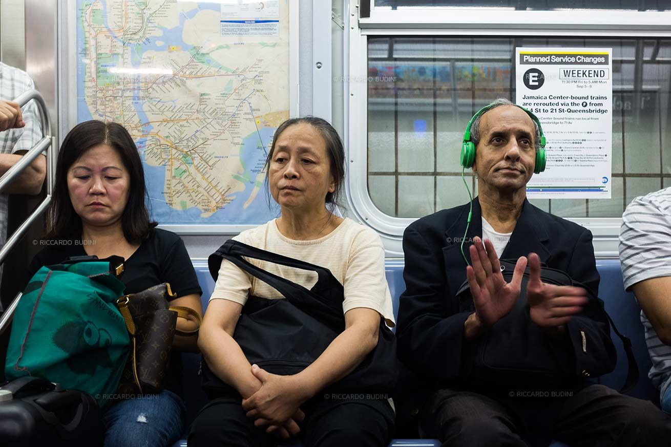 Guy enjoys music on the E train