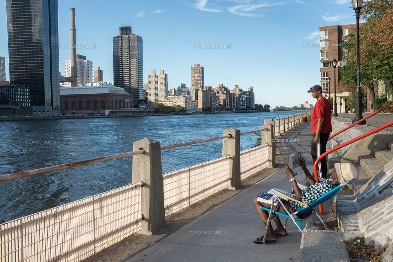 A woman enjoys the last rays of sun in Roosevelt Island.
