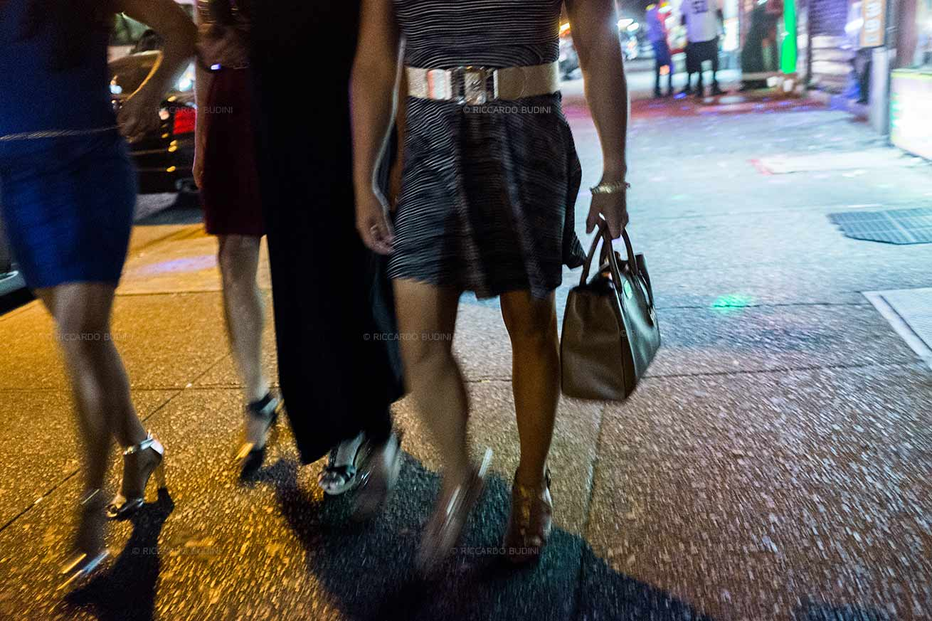 A Friday night in Roosevelt Avenue, Jackson Heights. New York, USA.
